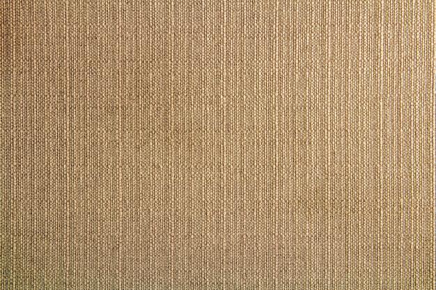 Натуральная ткань льняная текстура для дизайна, вретище текстурированная. коричневый холст фон. хлопок. Premium Фотографии
