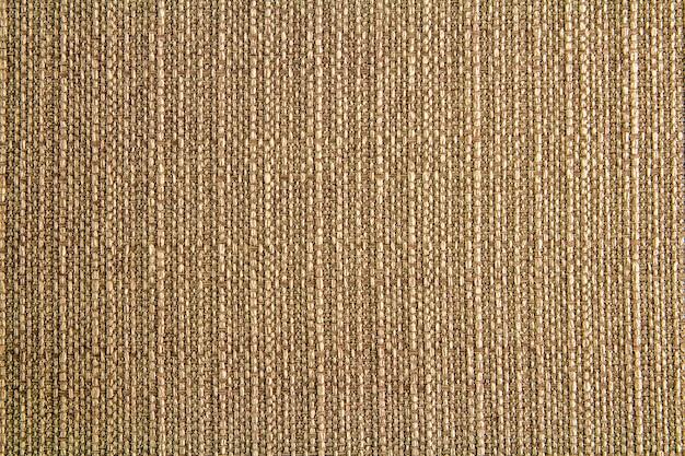 Натуральная ткань льняная текстура дизайн. вретище текстурированное. коричневый холст фон. хлопок. Premium Фотографии