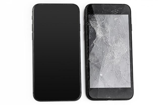 Мобильный телефон с разбитым экраном Premium Фотографии