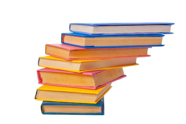 白で隔離される本の山 Premium写真