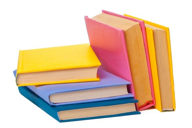 Куча книг, изолированные на белом Premium Фотографии
