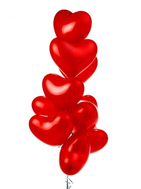 赤いハート型風船の束 Premium写真