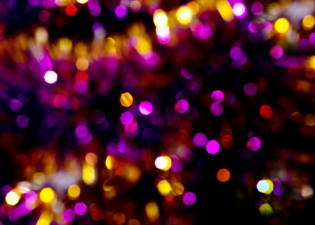 Размытие боке света. рождество расфокусированным фоном. Premium Фотографии