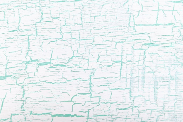 ひびの入った背景を描いた抽象的な白と緑。 Premium写真