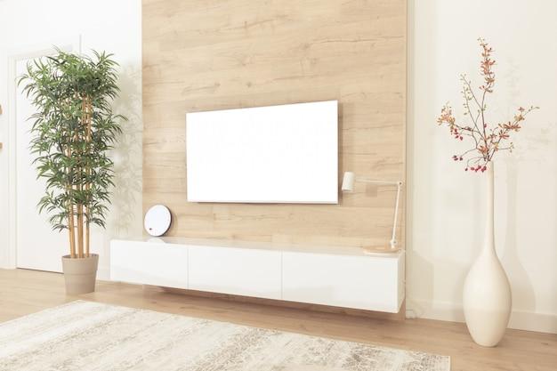 リビングルームの壁に掛かっている空白のモダンなフラットスクリーンテレビ Premium写真