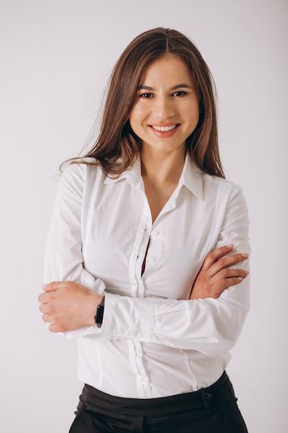 白い背景で隔離の白いシャツのビジネスウーマン 無料写真