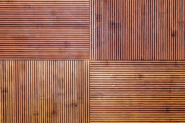 Деревенская бамбуковая текстура. горизонтальные и вертикальные линии. охристые и коричневые тона. Premium Фотографии