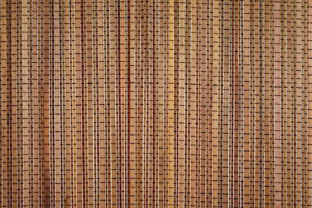 Бамбуковый свет предпосылки текстуры и естественный цвет. Premium Фотографии