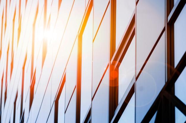 オフィスビルの窓の背景。 Premium写真