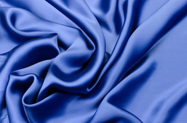 Шелковая атласная ткань синего цвета Premium Фотографии