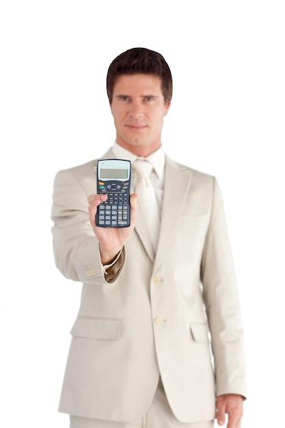 深刻なビジネスマンは、電卓を表示 Premium写真