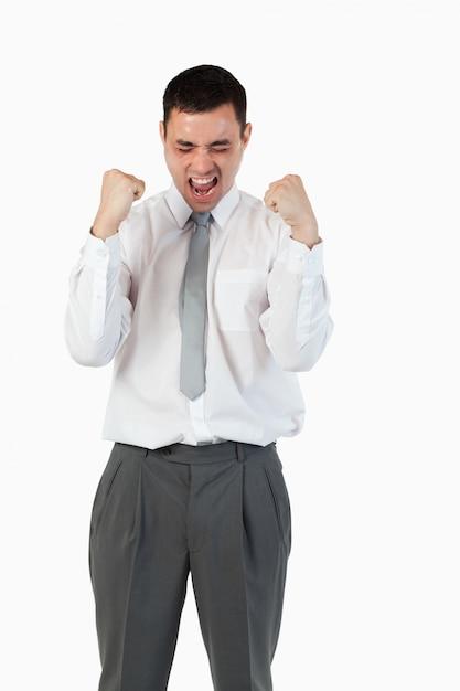 拳を上げた若い実業家の肖像 Premium写真