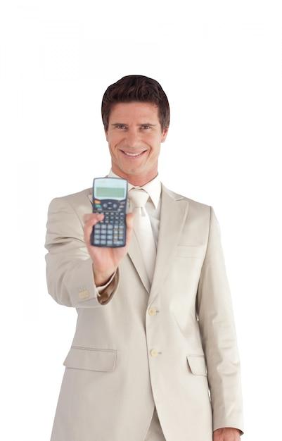 計算機を持っているハンサムなビジネスマン Premium写真