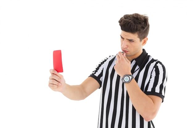 Судья стерна показывает красную карточку Premium Фотографии