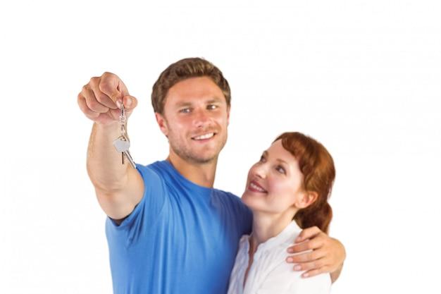 家に鍵を持っているカップル Premium写真