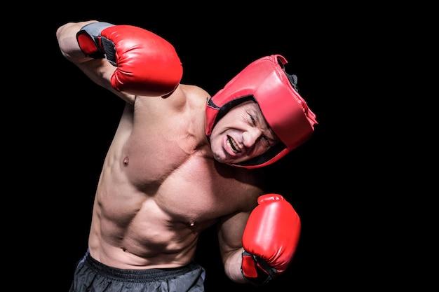 Агрессивный боксер на черном фоне Premium Фотографии