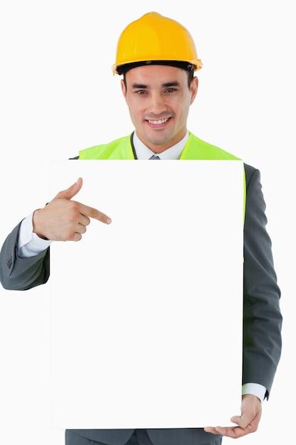 彼の手でサインを指している笑顔の建築家 Premium写真