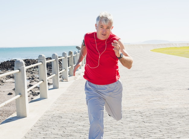 Mature Woman Jogging In The Park Stock Photo