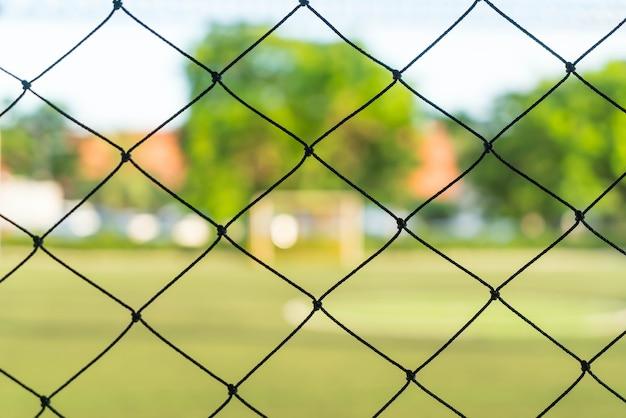 サッカーフィールドの背景とクローズアップネット 無料写真