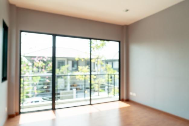 抽象的なぼかしの窓と家の中で空の部屋 Premium写真