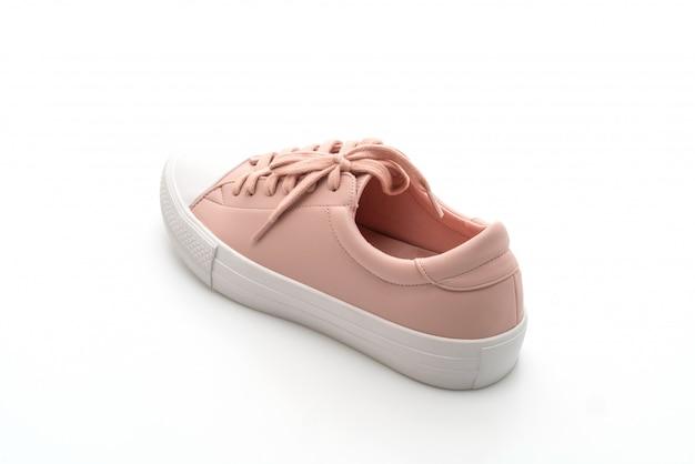 白地にピンクのスニーカーの靴 Premium写真