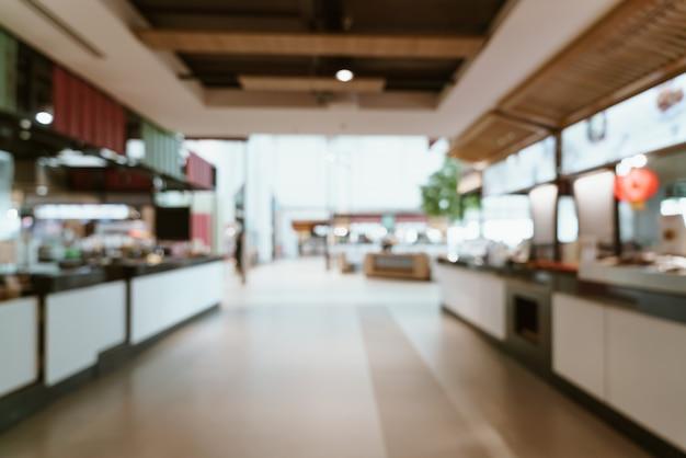 ショッピングモールの抽象的なぼかしと多重フードコートセンター Premium写真