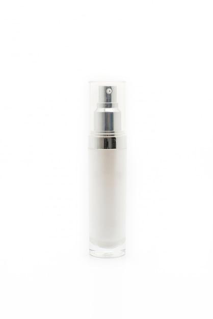 白い背景の上の血清ボトル Premium写真