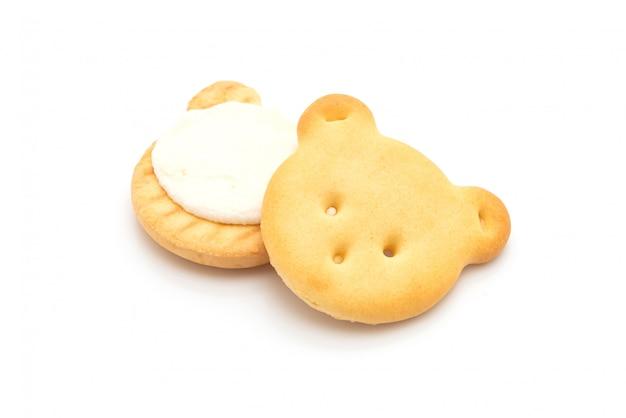 Несут печенье со сливками Premium Фотографии