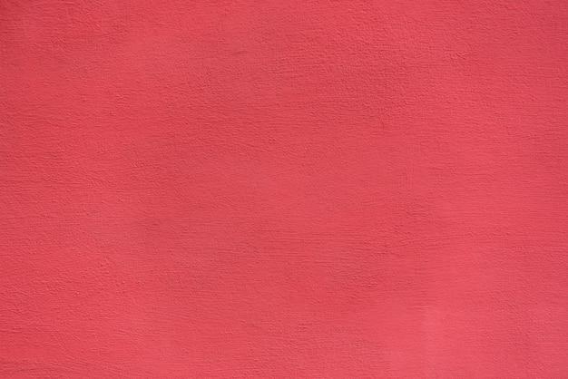 Яркая грубая оштукатуренная поверхность. живой коралловый окрас. фоны и текстуры Premium Фотографии