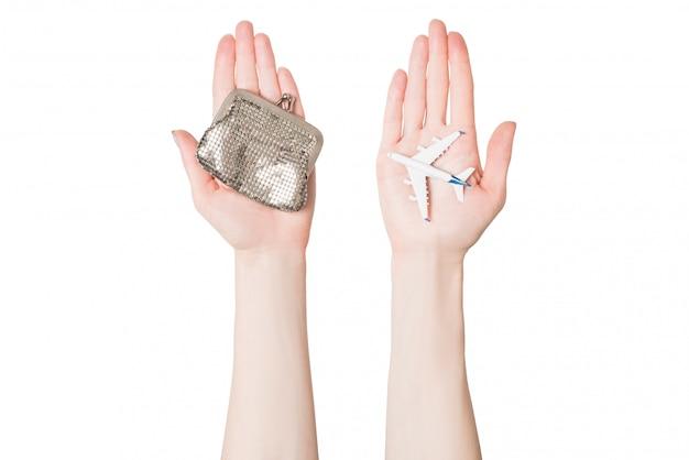 旅客機と女性の手のひらに財布。格安航空 Premium写真