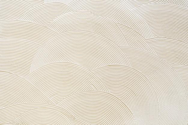 Круглые узоры на белой штукатурке. абстрактная текстура Premium Фотографии