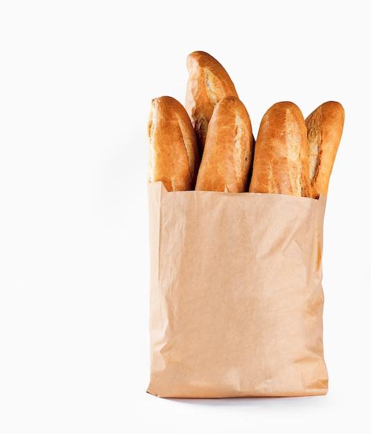 紙袋にバゲットのパン Premium写真