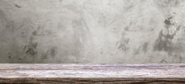 古い灰色のコンクリートのぼかしテクスチャ上の木製テーブルディスプレイ Premium写真