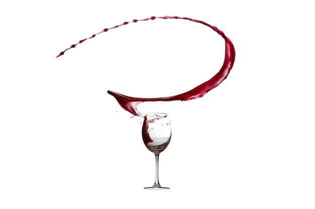 白で隔離される赤ワインの抽象的なしぶき Premium写真