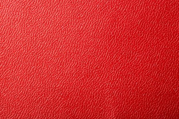 Красная текстурированная кожа фон. Premium Фотографии