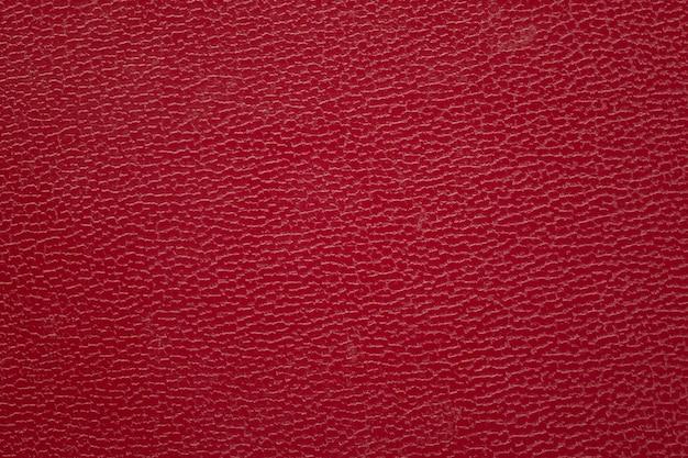 Красный текстурированный фон кожи Premium Фотографии