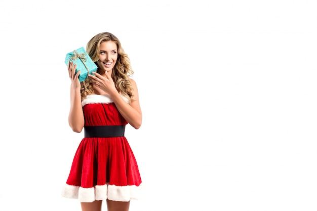 クリスマスプレゼントで美しいセクシーな女性 Premium写真