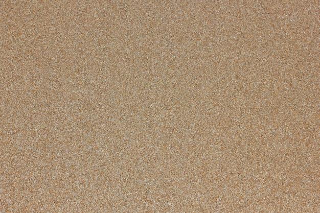 均質なベージュの黄色い砂の海洋構造の背景 Premium写真
