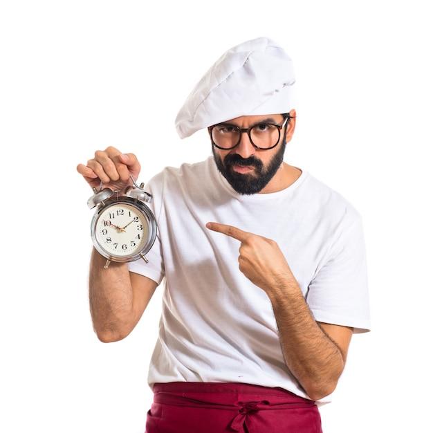 Шеф-повар, проведение часы на белом фоне Бесплатные Фотографии