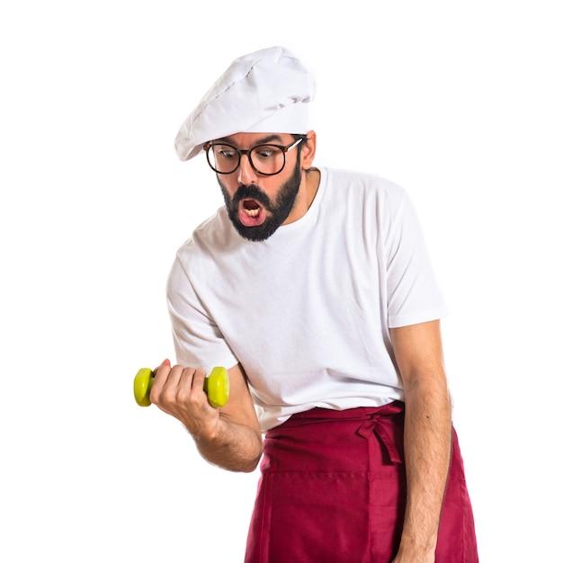 Шеф-повар делает тяжелую атлетику Бесплатные Фотографии