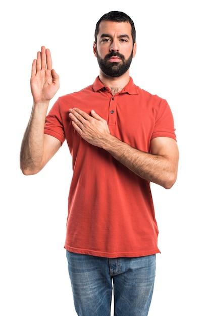 宣誓をするハンサムな男 無料写真