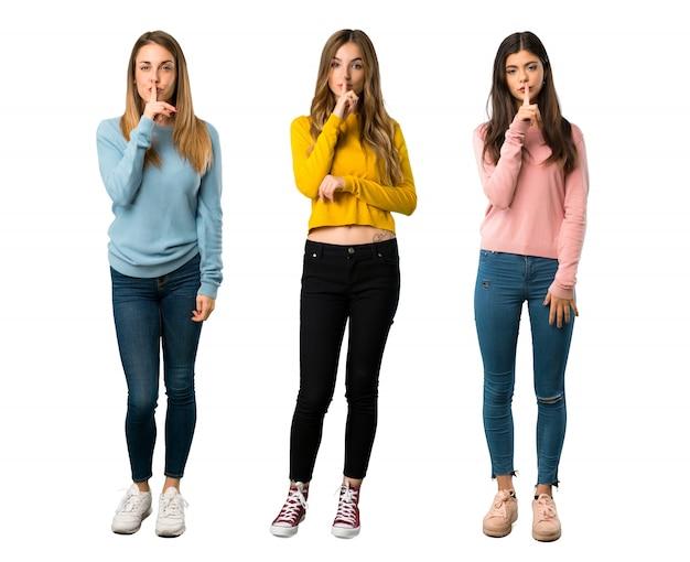 色とりどりの服を着た人々のグループの全身ショット Premium写真