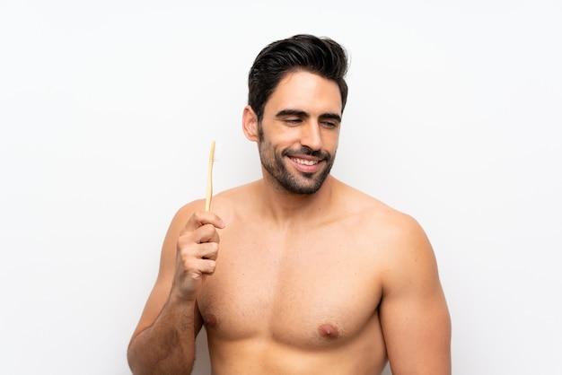 孤立した白で歯を磨く男 Premium写真