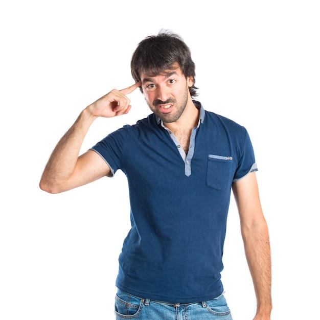 白い背景の上で狂ったジェスチャーを作る男 無料写真