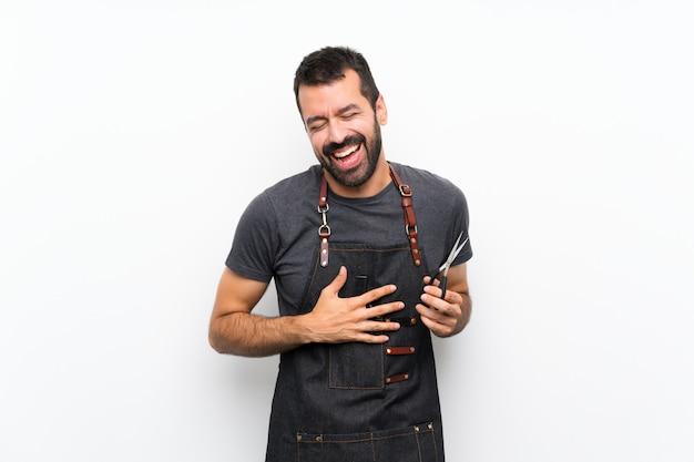 多くの笑みを浮かべてエプロンの理髪師 Premium写真
