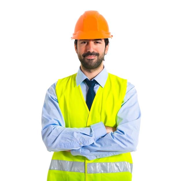 彼の腕を持つ労働者は、交差した 無料写真