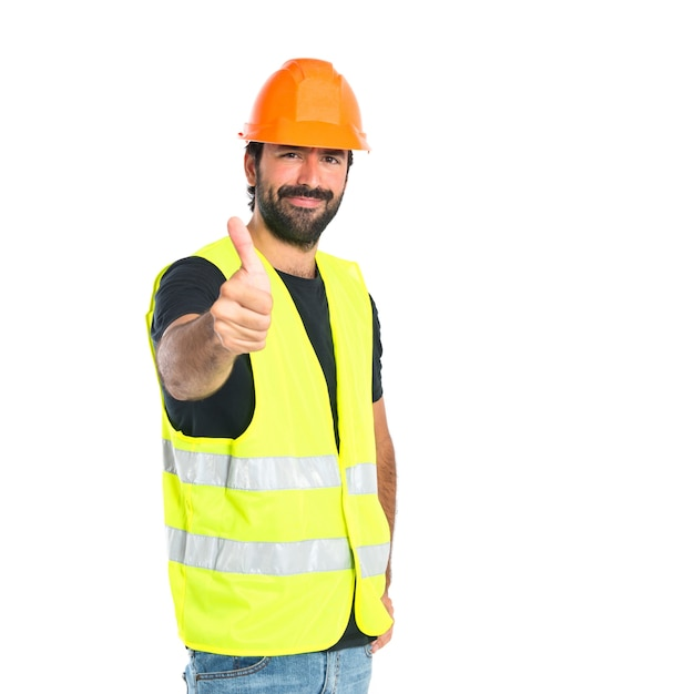 白い背景の上に親指を持つ労働者 無料写真