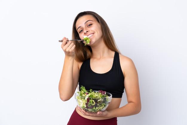 サラダとティーンエイジャーの女の子 Premium写真