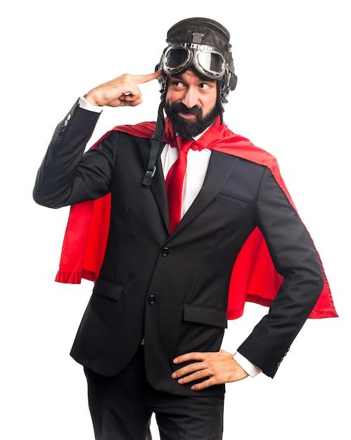 クレイジージェスチャーを作るスーパーヒーローのビジネスマン 無料写真