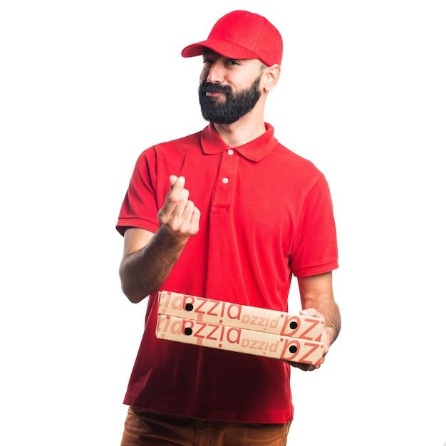 お金のジェスチャーをしているピザの配達男 無料写真